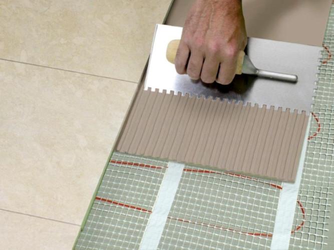 Укладка плитки на теплый пол